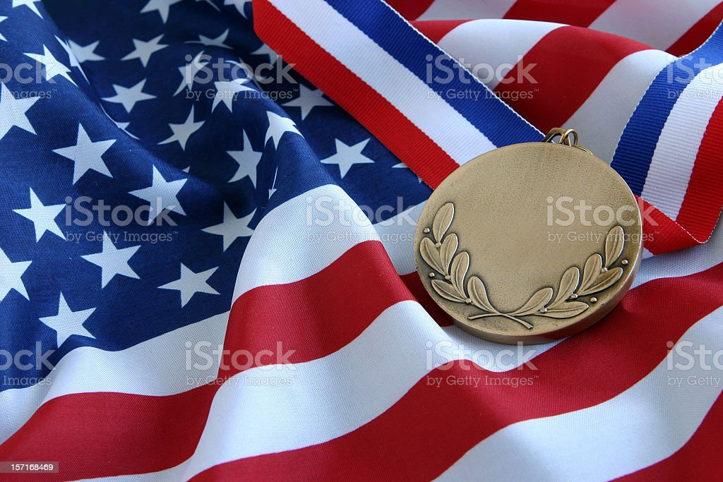 Gold Medal and US Flag royalty-free stock photo