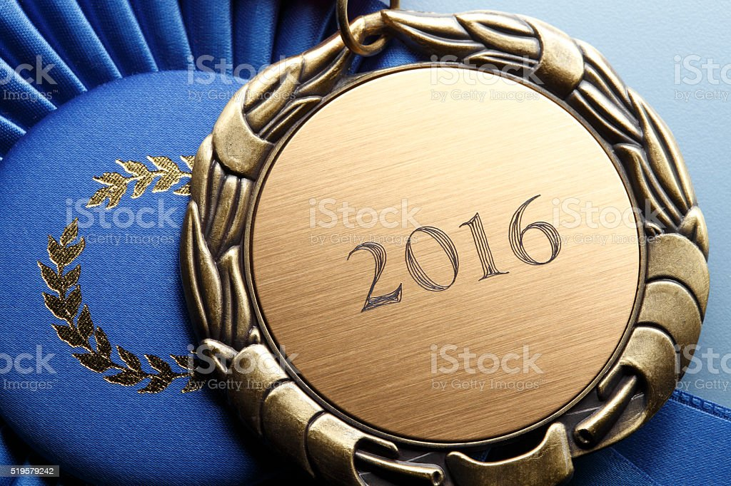 Gold Medal Engraved With 2016 Resting On Blue Ribbon stock photo