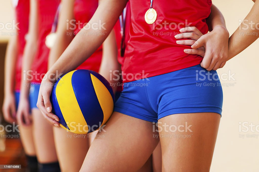 Gold medal female volleyball team. royalty-free stock photo