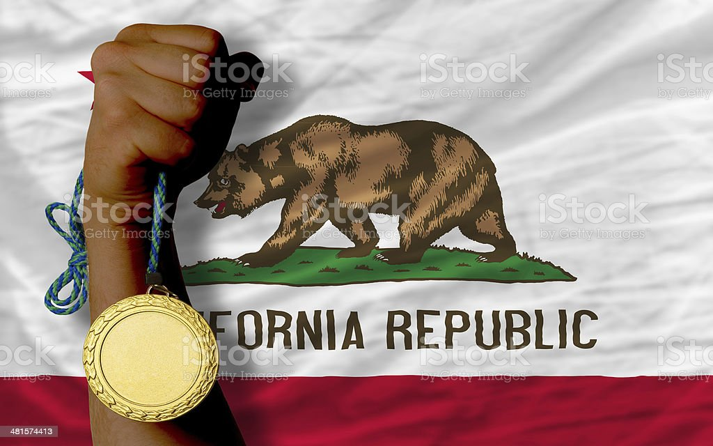 Gold medal for sport and  flag of american state california stock photo