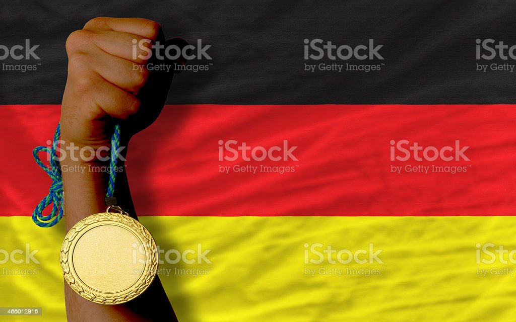 Gold medal for sport and flag of germany stock photo