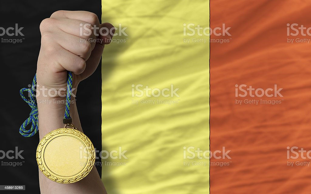 Gold medal for sport and  national flag of belgium stock photo