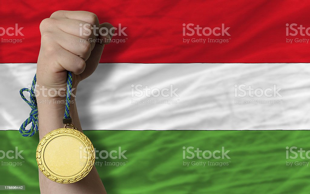 Gold medal for sport and  national flag of hungary royalty-free stock photo