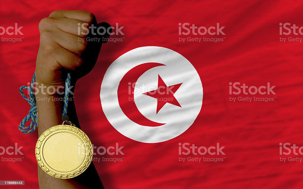 Gold medal for sport and  national flag of tunisia royalty-free stock photo