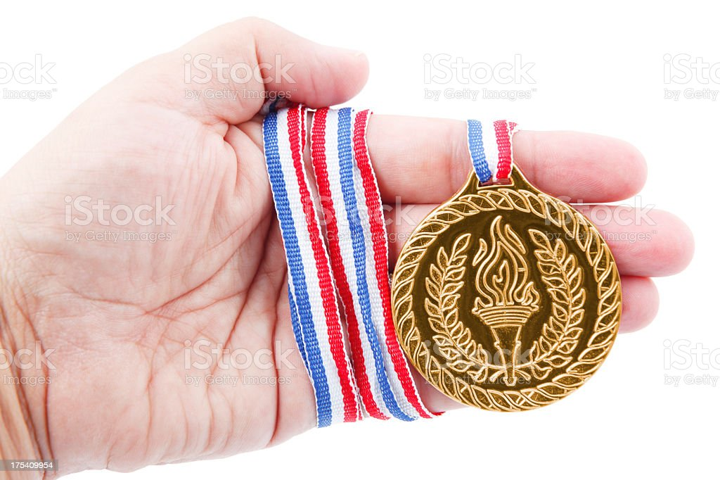 Gold medal in hand royalty-free stock photo