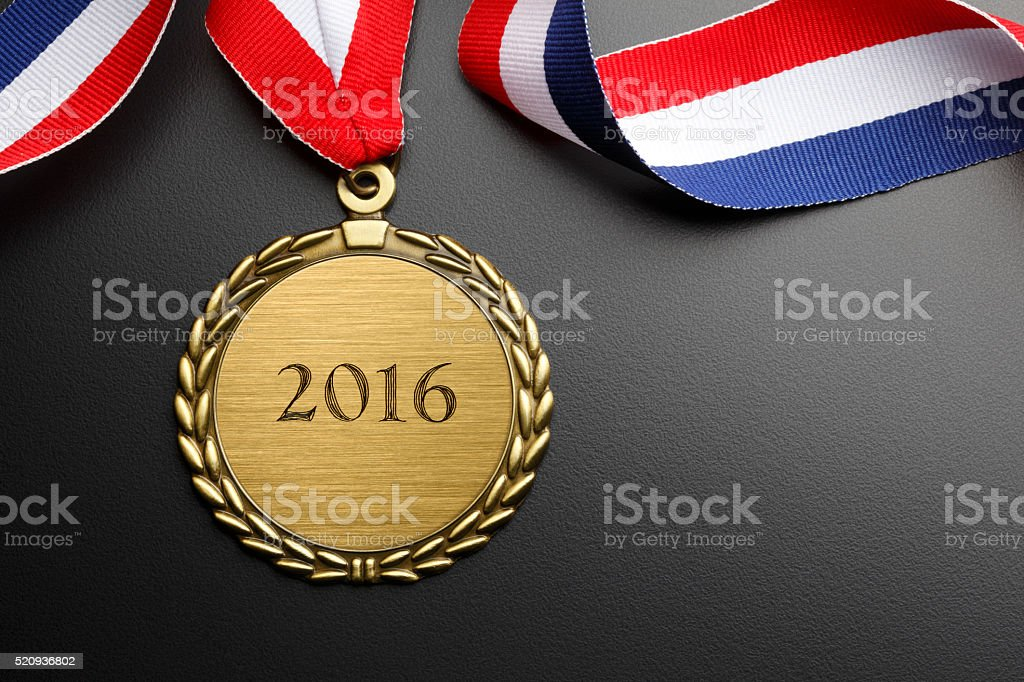 Gold Medal Inscribed With 2016 On Dark Gray Background stock photo