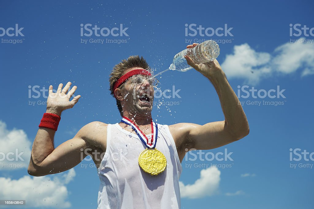 Gold Medal Nerd Athlete Splashes His Face with Water royalty-free stock photo