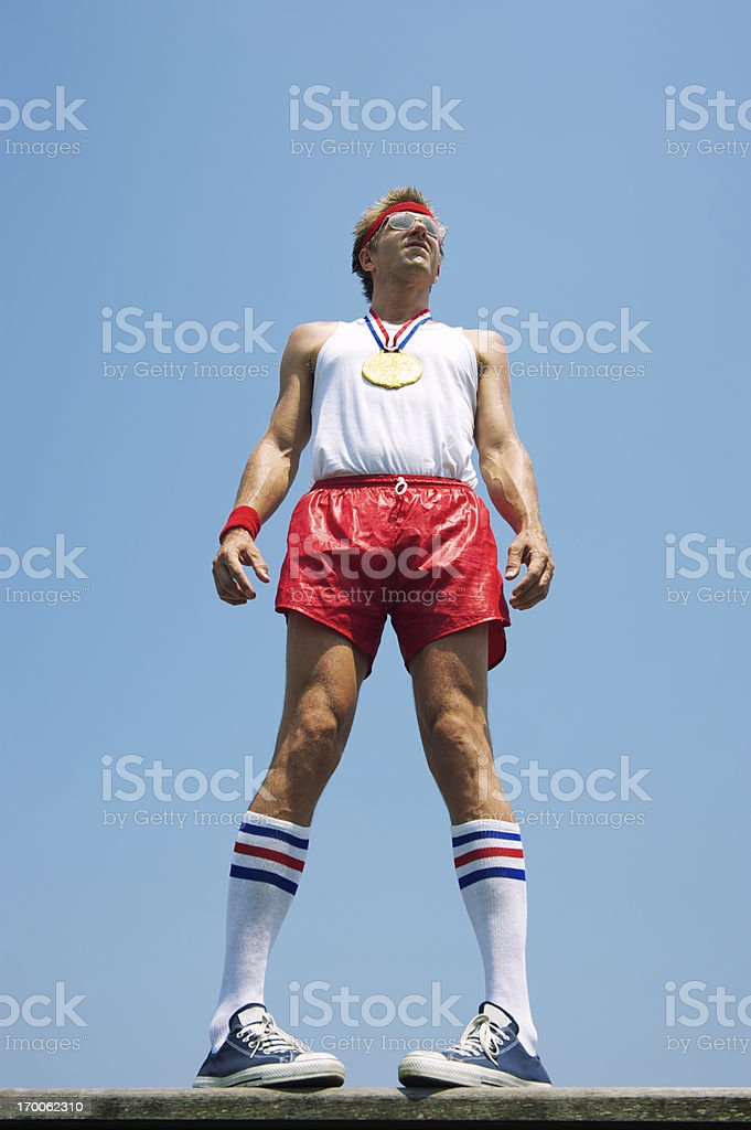 Gold Medal Nerd Athlete Stands Looking Unsure royalty-free stock photo