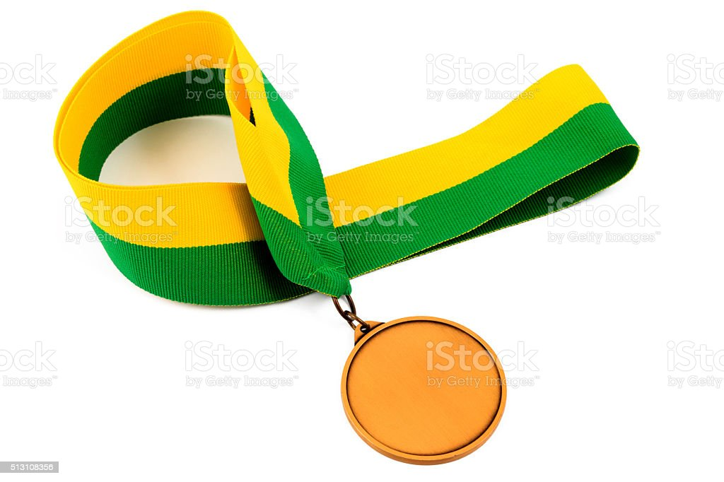 Gold medal on yellow green ribbon stock photo