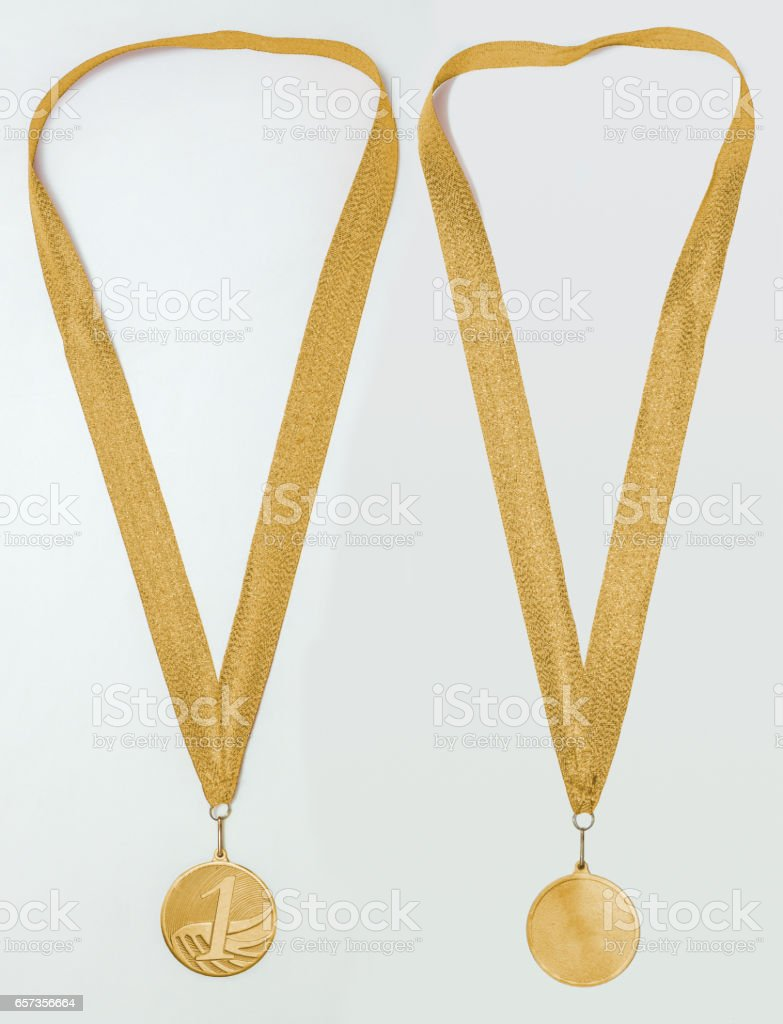 Gold medal with ribbon, two sides, isolated stock photo