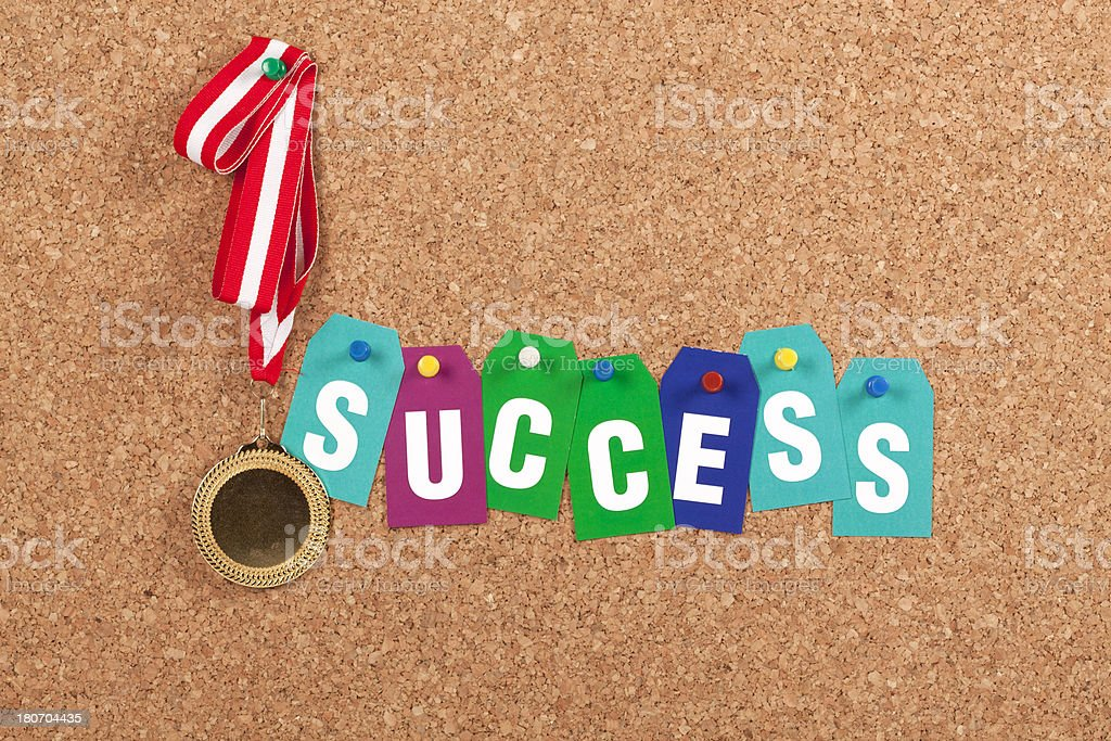 Gold Medal with Success Letter on Corkboard royalty-free stock photo