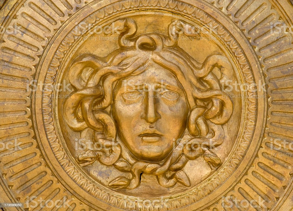 Gold Medusa plaque. stock photo