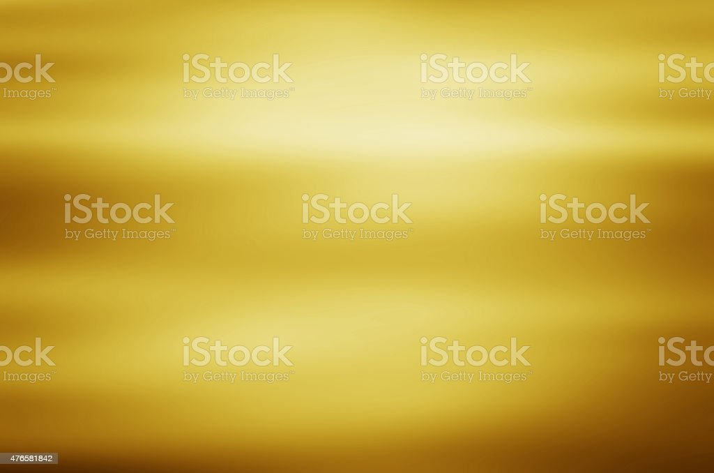 gold metal texture background with horizontal beams of light stock photo