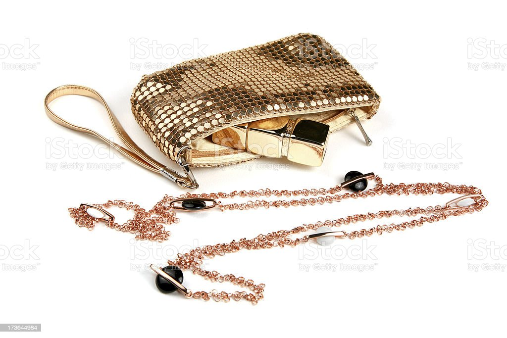 Gold metallic purse and necklace stock photo