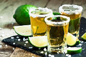 Gold Mexican tequila with lime and salt