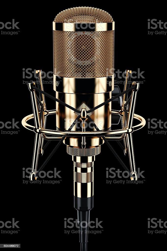 Gold microphone audio studio on black background stock photo
