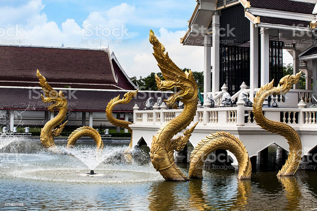 Gold Naga (Dragon, great snake) with fountain. royalty-free stock photo