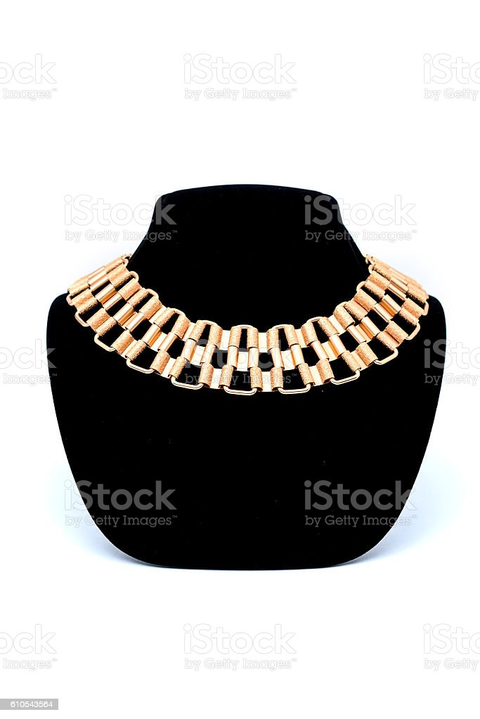 gold necklace on a mannequin stock photo