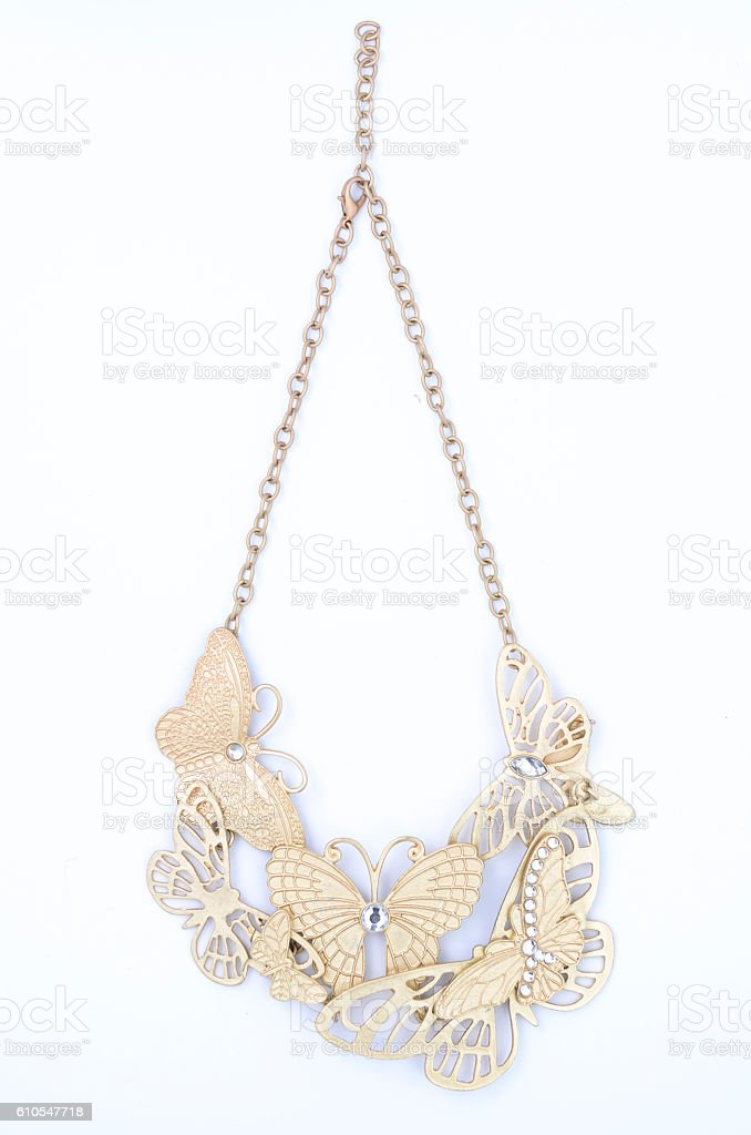 gold necklace with butterflies isolated on white stock photo