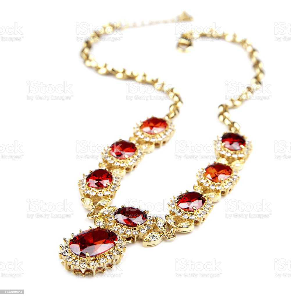Gold necklace with eight red gems stock photo