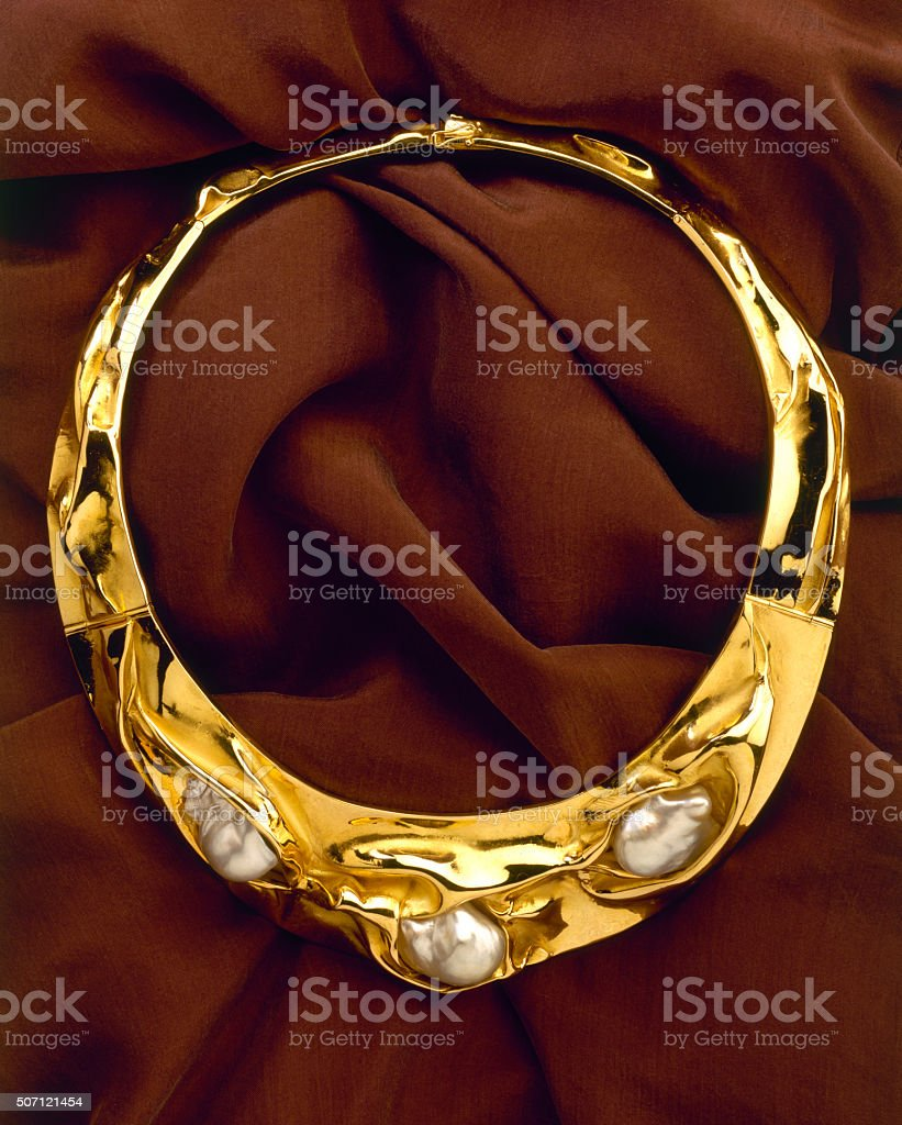 gold necklace with oyster pearl stock photo