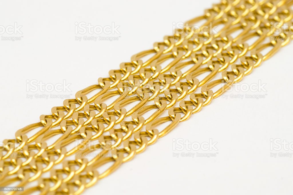 Gold necklaces arranged nicely in a row stock photo