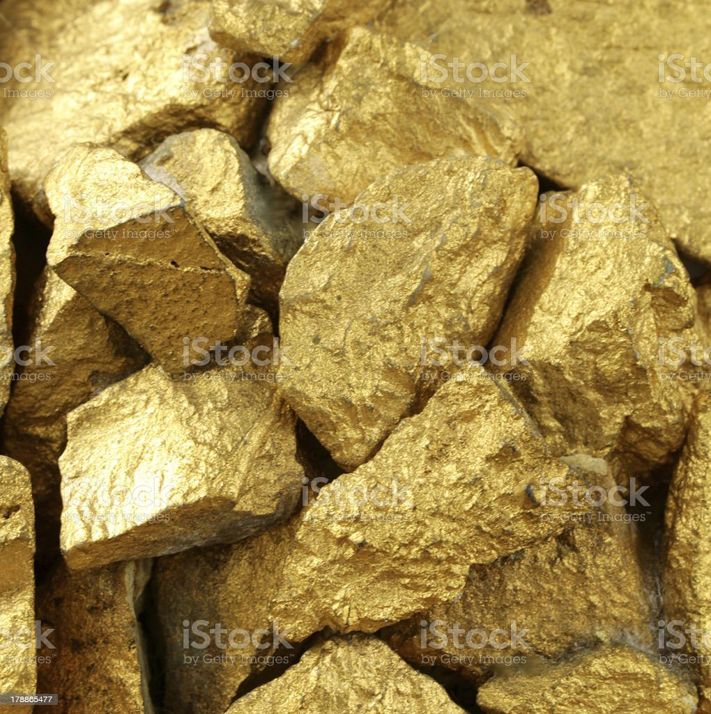gold nuggets many pieces as the background royalty-free stock photo