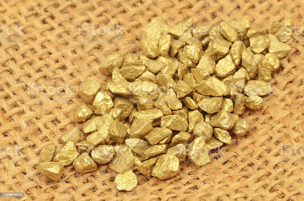 Gold nuggets on bag royalty-free stock photo