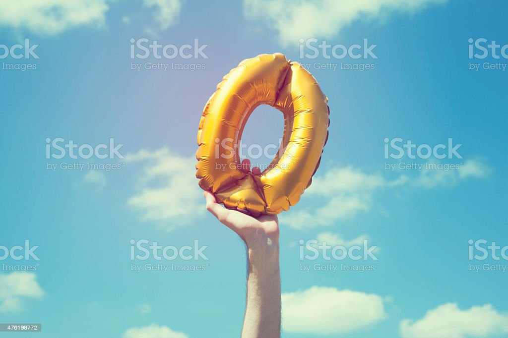 Gold number 0 balloon stock photo