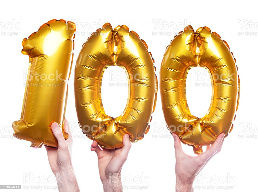 Gold number 100 balloons stock photo