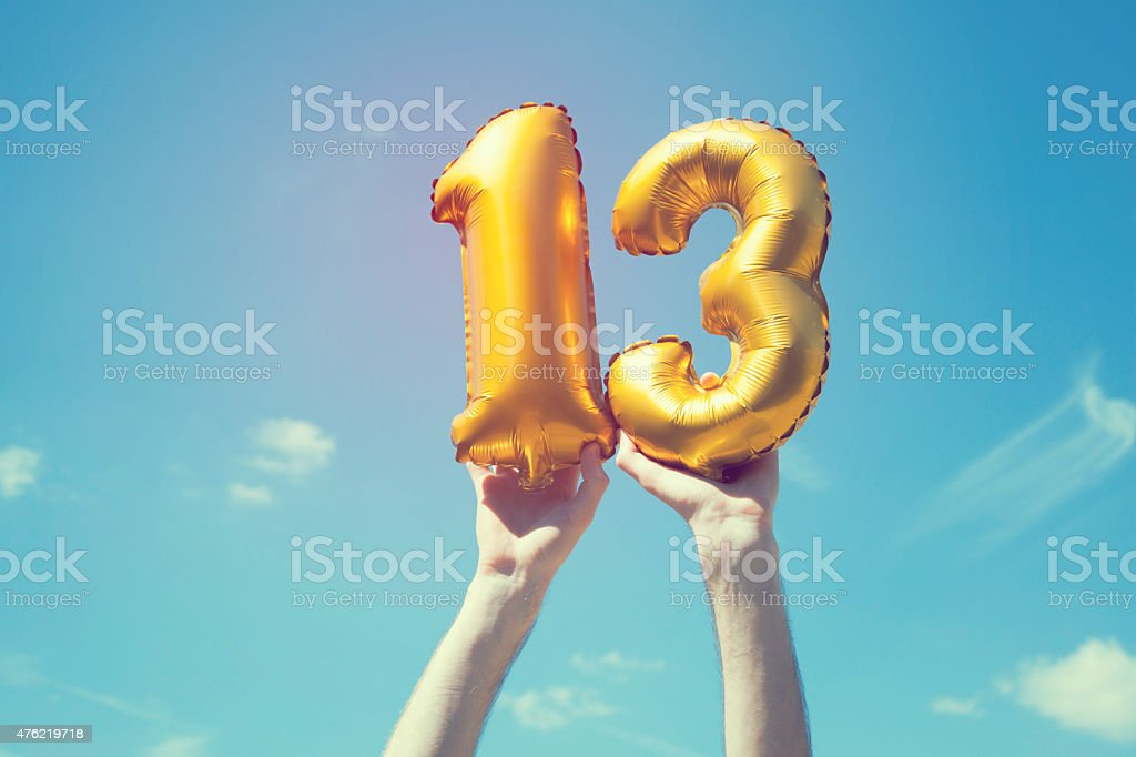Gold number 13 balloon stock photo
