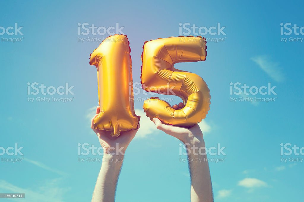 Gold number 15 balloon stock photo