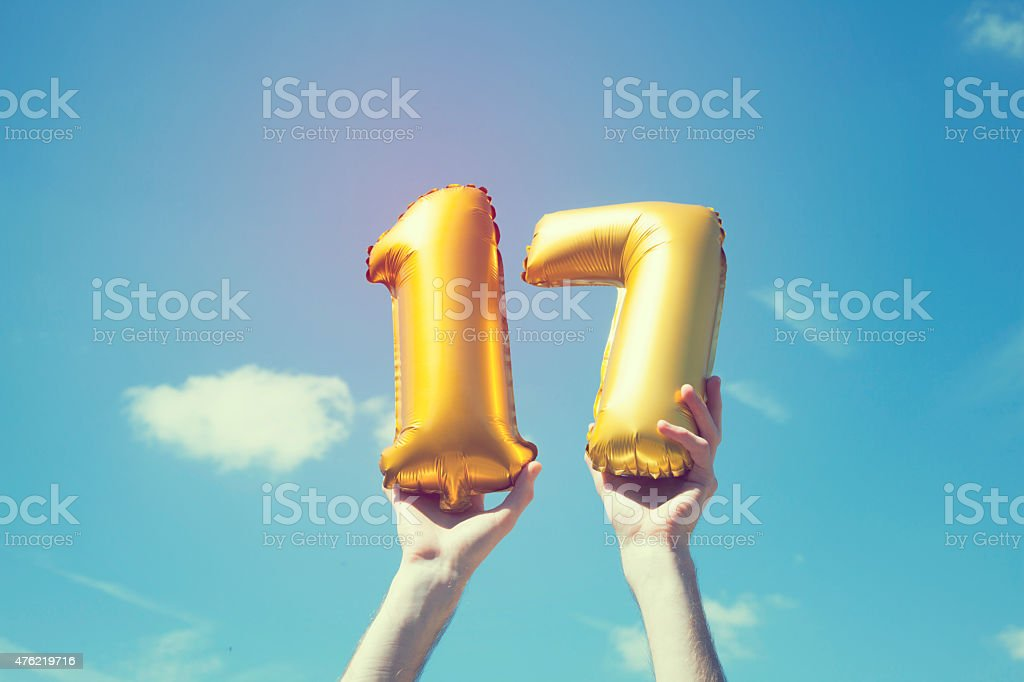 Gold number 17 balloon stock photo