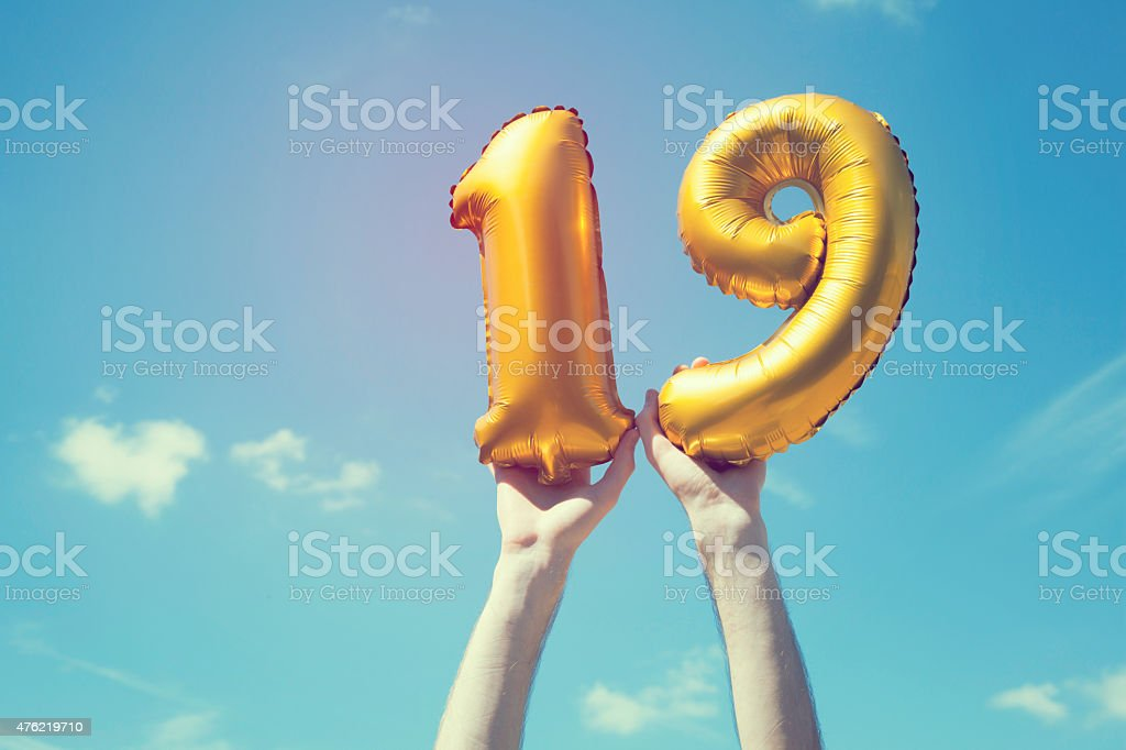 Gold number 19 balloon stock photo
