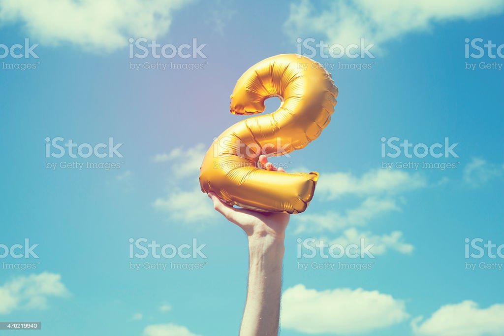 Gold number 2 balloon stock photo