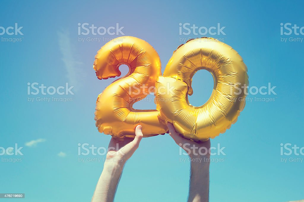 Gold number 20 balloon stock photo
