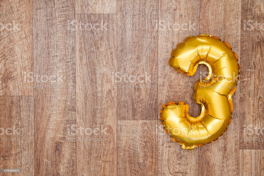 Gold number 3 balloon stock photo