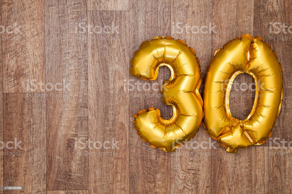 Gold number 30 balloon stock photo