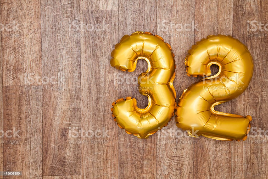 Gold number 32 balloon stock photo