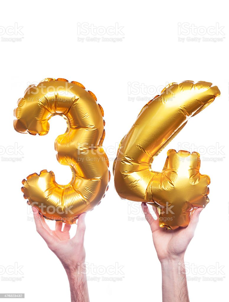 Gold number 34 balloons stock photo