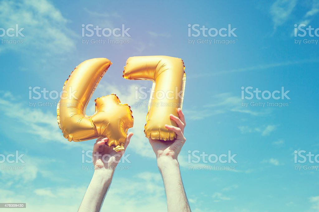 Gold number 47 balloon stock photo