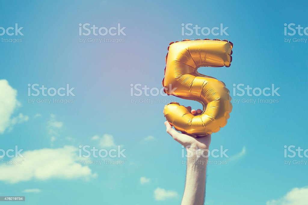 Gold number 5 balloon stock photo