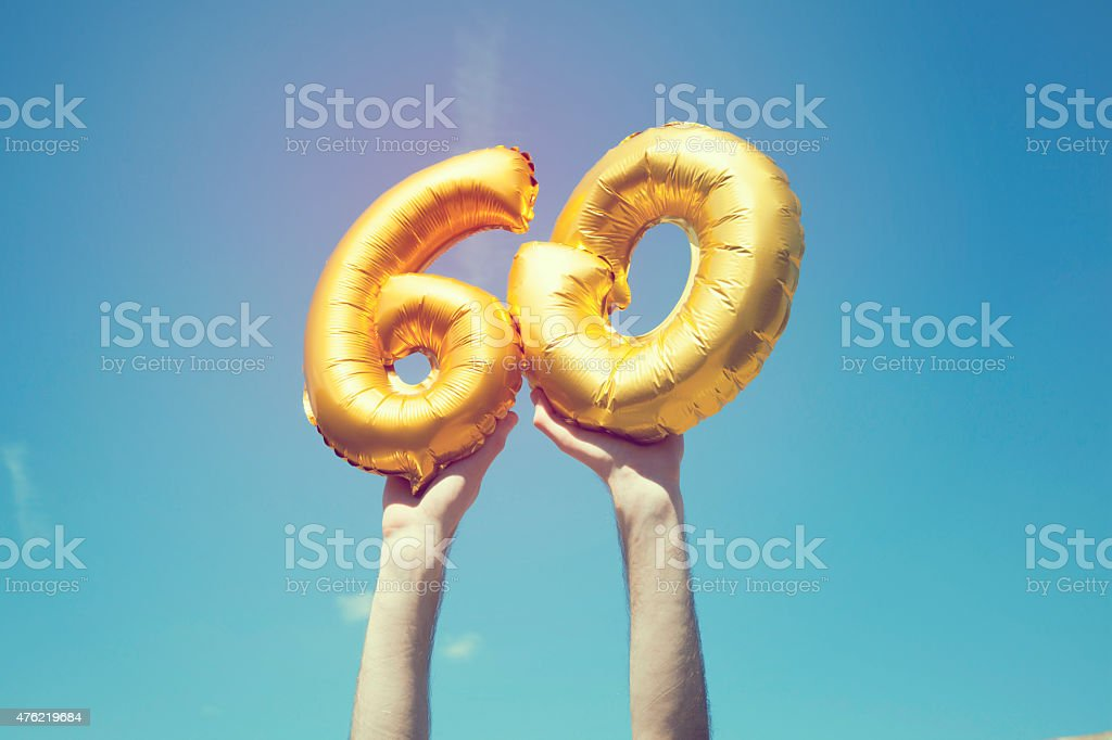 Gold number 60 balloon stock photo