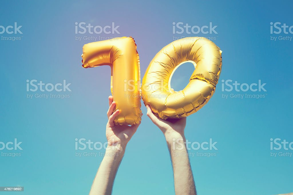 Gold number 70 balloon stock photo
