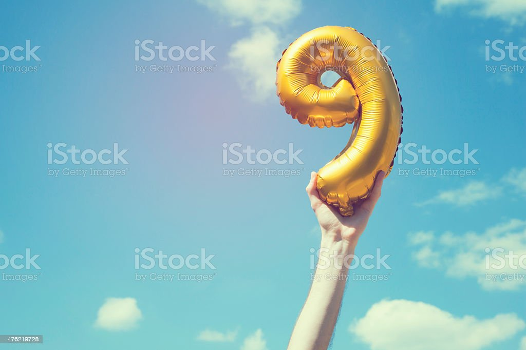 Gold number 9 balloon stock photo