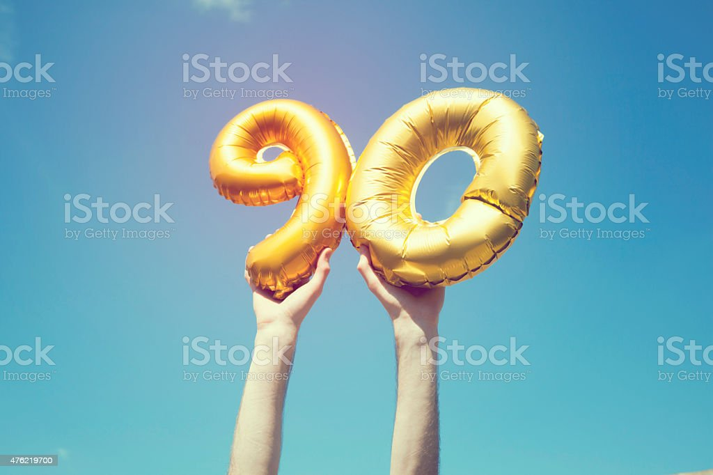 Gold number 90 balloon stock photo