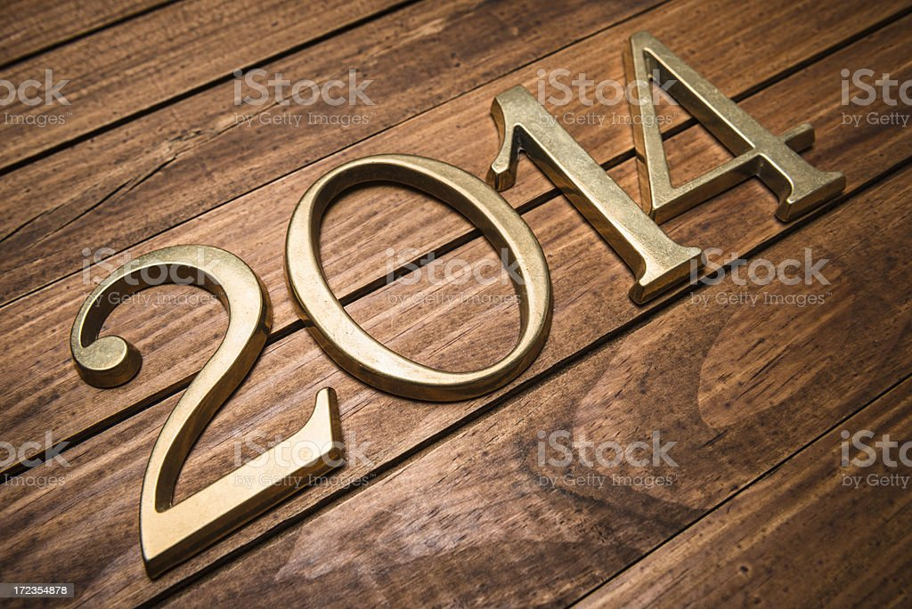 2014 gold numbers on wood background royalty-free stock photo