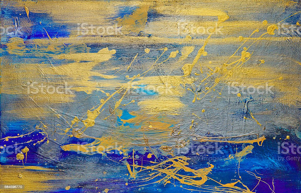 gold oil paint smeared on blue canvas stock photo