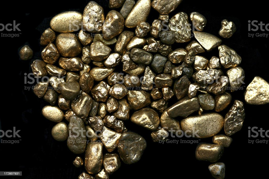 Gold on black stock photo