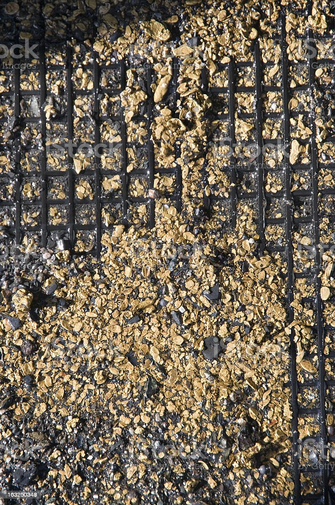 Gold on the rubber mat (fragment). stock photo